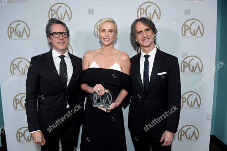 Charles Randolph, Charlize Theron, Jay Roach. Charles Randolph, from left, Charlize Theron, and Jay Roach, winners of the Stanley Kramer Award, attend the 31st Annual Producers Guild Awards at the Hollywood Palladium, in Los Angeles