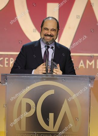 Craig Mazin accepts the David L. Wolper Award for outstanding producer of limited series television at the 31st Annual Producers Guild Awards at the Hollywood Palladium, in Los Angeles
