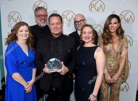 "Adam McKay, Kate Beckinsale. The producers of ""Succession"", winners of the Norman Felton award for outstanding producers of episodic television - drama, pose with Kate Beckinsale at the 31st Annual Producers Guild Awards at the Hollywood Palladium, in Los Angeles"