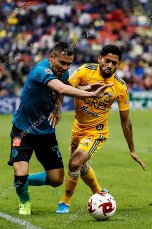 Stock Photo of America's defender Paul Aguilar (L) in action against Tigre's midfielder Javier Aquino (R) during a day two match of the Mexican Clausura Tournament played at the Azteca Stadium in Mexico City, Mexico, 18 January 2020.