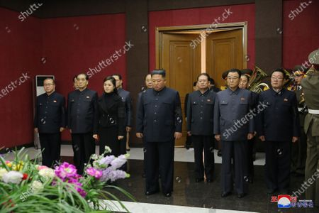 A photo released by the official North Korean Central News Agency (KCNA) shows Kim Jong Un (C, front), chairman of the Workers' Party of Korea and supreme commander of the armed forces of the North Korea, and his wife Ri Sol Ju (C, left, front), paying their condolences to anti-Japanese revolutionary fighter Hwang Sun Hui, deputy to the North Korea Supreme People's Assembly (SPA) and curator of the Korean Revolution Museum, in Pyongyang, North Korea, 17 January 2020 (19 January 2020).