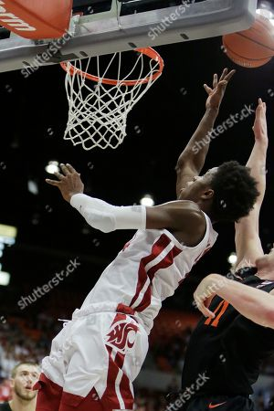 Washington State guard Noah Williams, left, shoot sin front of Oregon State guard Zach Reichle during the second half of an NCAA college basketball game in Pullman, Wash