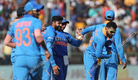 India's captain Virat Kohli, second right, gestures to celebrate after taking the catch to dismiss Australia's Marnus Labuschagne during the third one-day international cricket match between India and Australia in Bangalore, India