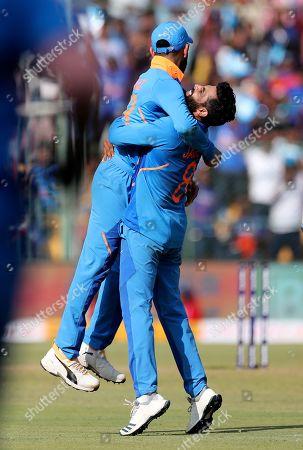 Ravindra Jadeja, Virat Kohli. India's Ravindra Jadeja, right, celebrates with captain Virat Kohli the dismissal of Australia's Marnus Labuschagne during the third one-day international cricket match between India and Australia in Bangalore, India