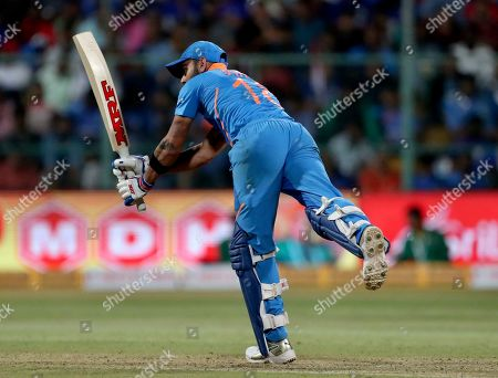 India's captain Virat Kohli bats during the third one-day international cricket match between India and Australia in Bangalore, India