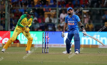 Virat Kohli, Alex Carey. India's captain Virat Kohli, right, reacts after an unsuccessful attempt by Australia's wicketkeeper Alex Carey, left, to dismiss him during the third one-day international cricket match between India and Australia in Bangalore, India