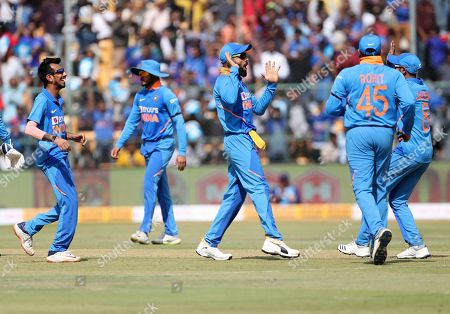India's captain Virat Kohli, center, and teammates celebrate the dismissal of Australia's captain Aaron Finch during the third one-day international cricket match between India and Australia in Bangalore, India