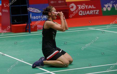 Ratchanok Intanon of Thailand jubilates after defeating Carolina Marin of Spain  (unseen)  during their  women single's  final match at the Daihatsu Indonesian Masters badminston tournament in Jakarta, Indonesia 19 January 2020