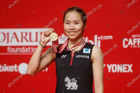 Ratchanok Intanon of Thailand holds her medal  after defeating Carolina Marin of Spain  (unseen)  during their  women single's final  match at the Daihatsu Indonesian Masters badminston tournament in Jakarta, Indonesia 19 January 2020.
