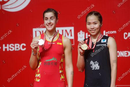 Ratchanok Intanon (R) of Thailand and Carolina Marin (L) of Spain  hold their medals after  their  women single's final  match at the Daihatsu Indonesian Masters badminston tournament in Jakarta, Indonesia 19 January 2020.