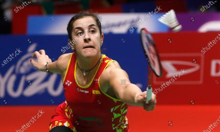Carolina Marin of Spain in action against Ratchanok Intanon of Thailand (unseen)  during their  women single's final  match at the Daihatsu Indonesian Masters badminston tournament in Jakarta, Indonesia 19 January 2020
