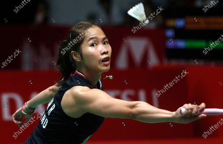 Ratchanok Intanon of Thailand in action against  Carolina Marin of Spain  (unseen)  during their  women single's final  match at the Daihatsu Indonesian Masters badminston tournament in Jakarta, Indonesia 19 January 2020