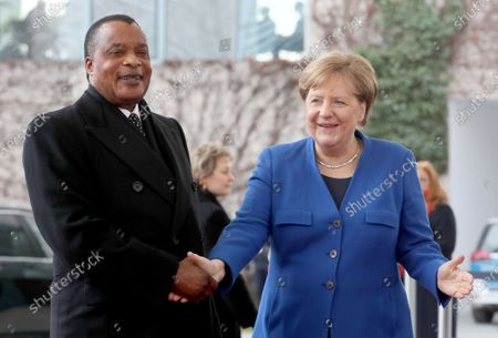 German Chancellor Angela Merkel (R) welcomes the President of the Republic of the Congo, Denis Sassou Nguesso, for the International Libya Conference in Berlin, Germany, 19 January 2020. By means of the 'Berlin Process', German government seeks to support the peace efforts of the United Nations (UN) to bring about an end to the conflict in Libya. Following the renewed outbreak of hostilities in April 2019, UN presented a plan to stop further military escalation and resume an intra-Libyan process of reconciliation.
