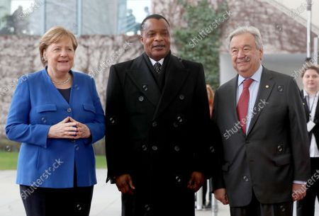 German Chancellor Angela Merkel (L) welcomes the President of the Republic of the Congo, Denis Sassou Nguesso, (C) next to Secretary General of the United Nations (UN), Antonio Guterres for the International Libya Conference in Berlin, Germany, 19 January 2020. By means of the 'Berlin Process', German government seeks to support the peace efforts of the United Nations (UN) to bring about an end to the conflict in Libya. Following the renewed outbreak of hostilities in April 2019, UN presented a plan to stop further military escalation and resume an intra-Libyan process of reconciliation.