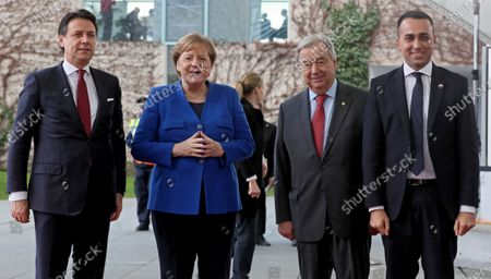 German Chancellor Angela Merkel (2-L) welcomes Italian Prime Minister Giuseppe Conte (L) and Italian Foreign Minister Luigi Di Maio (R) next to Secretary General of the United Nations (UN), Antonio Guterres (2-R) for the International Libya Conference in Berlin, Germany, 19 January 2020. By means of the 'Berlin Process', German government seeks to support the peace efforts of the United Nations (UN) to bring about an end to the conflict in Libya. Following the renewed outbreak of hostilities in April 2019, UN presented a plan to stop further military escalation and resume an intra-Libyan process of reconciliation.