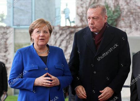 German Chancellor Angela Merkel (L) welcomes Turkish President Recep Tayyip Erdogan (R) during the International Libya Conference in Berlin, Germany, 19 January 2020. By means of the 'Berlin Process', German government seeks to support the peace efforts of the United Nations (UN) to bring about an end to the conflict in Libya. Following the renewed outbreak of hostilities in April 2019, UN presented a plan to stop further military escalation and resume an intra-Libyan process of reconciliation.