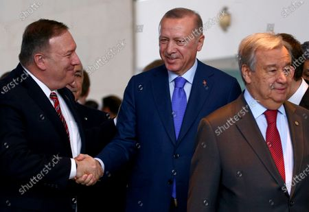 (L-R) US Secretary of State Mike Pompeo shakes hands with Turkish President Recep Tayyip Erdogan next to Secretary General of the United Nations (UN), Antonio Guterres during the International Libya Conference in Berlin, Germany, 19 January 2020. By means of the 'Berlin Process', German government seeks to support the peace efforts of the United Nations (UN) to bring about an end to the conflict in Libya. Following the renewed outbreak of hostilities in April 2019, UN presented a plan to stop further military escalation and resume an intra-Libyan process of reconciliation.