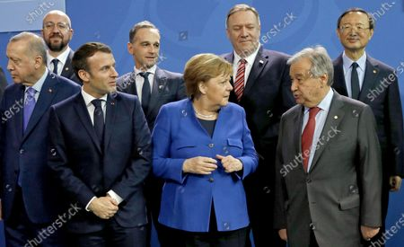 (L-R) Turkish President Recep Tayyip Erdogan, President of the EU Council Charles Michel, French President Emmanuel Macron, German Foreign Minister Heiko Maas, German Chancellor Angela Merkel, US Secretary of State Mike Pompeo, Secretary General of the United Nations (UN), Antonio Guterres and Chinese State Councilor Yang Jiechi prior to the family picture in Berlin, Germany, 19 January 2020. By means of the 'Berlin Process', German government seeks to support the peace efforts of the United Nations (UN) to bring about an end to the conflict in Libya. Following the renewed outbreak of hostilities in April 2019, UN presented a plan to stop further military escalation and resume an intra-Libyan process of reconciliation.