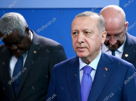 Turkish President Recep Tayyip Erdogan (C) stands in front of African Union Commission, Moussa Faki Mahamat (L) and President of the EU Council Charles Michel (R) prior to the family picture for the International Libya Conference in Berlin, Germany, 19 January 2020. By means of the 'Berlin Process', German government seeks to support the peace efforts of the United Nations (UN) to bring about an end to the conflict in Libya. Following the renewed outbreak of hostilities in April 2019, UN presented a plan to stop further military escalation and resume an intra-Libyan process of reconciliation.