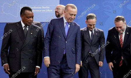 (L-R) President of the Republic of the Congo, Denis Sassou-Nguesso, President of the EU Council Charles Michel, Turkish President Recep Tayyip Erdogan, German Foreign Minister Heiko Maas  and US Secretary of State Mike Pompeo look for their family picture positions during the International Libya Conference in Berlin, Germany, 19 January 2020. By means of the 'Berlin Process', German government seeks to support the peace efforts of the United Nations (UN) to bring about an end to the conflict in Libya. Following the renewed outbreak of hostilities in April 2019, UN presented a plan to stop further military escalation and resume an intra-Libyan process of reconciliation.