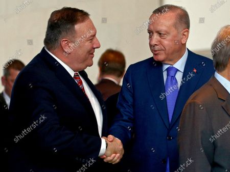 US Secretary of State Mike Pompeo (L) shakes hands with Turkish President Recep Tayyip Erdogan during the International Libya Conference in Berlin, Germany, 19 January 2020. By means of the 'Berlin Process', German government seeks to support the peace efforts of the United Nations (UN) to bring about an end to the conflict in Libya. Following the renewed outbreak of hostilities in April 2019, UN presented a plan to stop further military escalation and resume an intra-Libyan process of reconciliation.