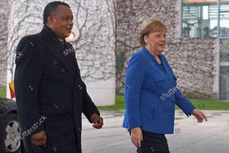 German Chancellor Angela Merkel (R) welcomes the President of the Republic of the Congo, Denis Sassou-Nguesso, for the International Libya Conference in Berlin, Germany, 19 January 2020. By means of the 'Berlin Process', the German government seeks to support the peace efforts of the United Nations (UN) to bring about an end to the conflict in Libya. Following the renewed outbreak of hostilities in April 2019, the UN presented a plan to stop further military escalation and resume an intra-Libyan process of reconciliation.