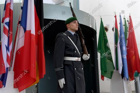 A sodier stands guard prior to the arrival of President of the Republic of the Congo, Denis Sassou-Nguesso, at the chancellery in Berlin, Germany, 19 January 2020. By means of the 'Berlin Process', the German government seeks to support the peace efforts of the United Nations (UN) to bring about an end to the conflict in Libya. Following the renewed outbreak of hostilities in April 2019, the UN presented a plan to stop further military escalation and resume an intra-Libyan process of reconciliation.