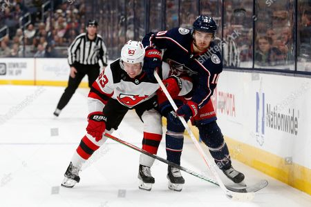 Columbus Blue Jackets forward Alexander Wennberg, right, of Sweden, chases the puck in front of New Jersey Devils forward Jesper Bratt, of Sweden, during an NHL hockey game in Columbus, Ohio, . The Blue Jackets won 5-0