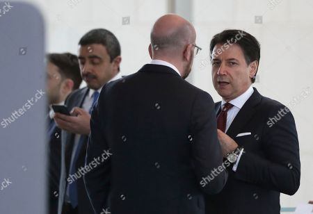 Stock Photo of Italian Prime Minister Giuseppe Conte, right, speaks with European Council President Charles Michel, center, during a conference on Libya at the chancellery in Berlin, Germany, . German Chancellor Angela Merkel hosts the one-day conference of world powers on Sunday seeking to curb foreign military interference, solidify a cease-fire and help relaunch a political process to stop the chaos in the North African nation