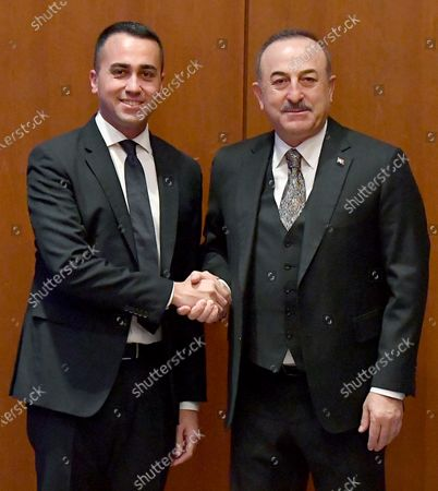 Italian Minister for Foreign Affairs Luigi Di Maio (L) shakes hands with Turkish Foreign Minister Mavlut Cavusoglu during their meeting in Berlin, Germany, 19 January 2020, on the sidelines of the International Libya Conference. The summit, which takes place in Berlin and sees the participation of various world leaders, including Internationally-recognized Prime Minister Fayez al-Serraj and renegade General Khalifa Haftar, will try to begin a process to reconcile the two Libyan rival leaders.