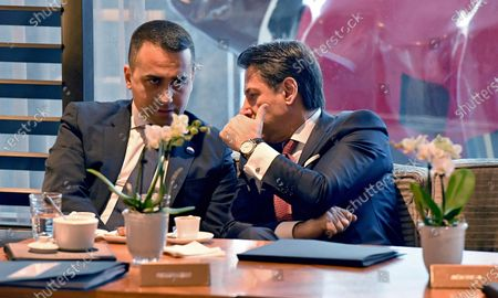 Italian Foreign Minister Luigi Di Maio (L) and Italian Prime Minister Giuseppe Conte (R) sit with fellow attendants to the International Libya Conference in Berlin, Germany, 19 January 2020. By means of the 'Berlin Process', German government seeks to support the peace efforts of the United Nations (UN) to bring about an end to the conflict in Libya. Following the renewed outbreak of hostilities in April 2019, UN presented a plan to stop further military escalation and resume an intra-Libyan process of reconciliation.