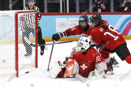 Japan's Makoto Ito (back C) scores the 5-0 lead against Switzerland's goalie Nadia Haener (front) and Alizee Aymon (R) during the women's Ice Hockey preliminary round group B game between Switzerland and Japan at the Lausanne 2020 Winter Youth Olympic Games at Vaudoises Arena in Lausanne, Switzerland, 19 January 2020.