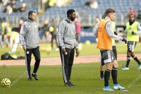 Leicester City first team coach Kolo Toure oversees the warm up at Turf Moor before the game