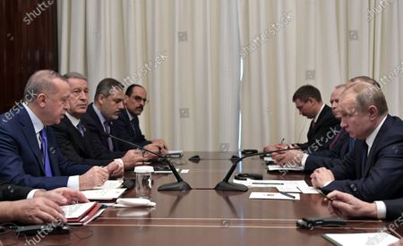 Turkish President Recep Tayyip Erdogan (L) and Russian President Vladimir Putinmeet for a bilateral on the sidelines of the International Libya Conference in Berlin, Germany, 19 January 2020. By means of the 'Berlin Process', German government seeks to support the peace efforts of the United Nations (UN) to bring about an end to the conflict in Libya. Following the renewed outbreak of hostilities in April 2019, UN presented a plan to stop further military escalation and resume an intra-Libyan process of reconciliation.