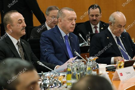 Turkish President Recep Tayyip Erdogan (C) and Turkish Foreign Minister Mevlut Cavusoglu (L), and Algerian President Abdelmadjid Tebboune attend the main session for the International Libya Conference in Berlin, Germany, 19 January 2020. By means of the 'Berlin Process', German government seeks to support the peace efforts of the United Nations (UN) to bring about an end to the conflict in Libya. Following the renewed outbreak of hostilities in April 2019, UN presented a plan to stop further military escalation and resume an intra-Libyan process of reconciliation.