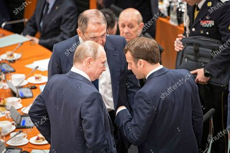 (L-R) Russian President Vladimir Putin, acting Russian foreign minister Sergei Lavrov, French Foreign Minister Jean-Yves Le Drian, and French President Emmanel Macron talk at the International Libya Conference in Berlin, Germany, 19 January 2020. By means of the 'Berlin Process', German government seeks to support the peace efforts of the United Nations (UN) to bring about an end to the conflict in Libya. Following the renewed outbreak of hostilities in April 2019, UN presented a plan to stop further military escalation and resume an intra-Libyan process of reconciliation.