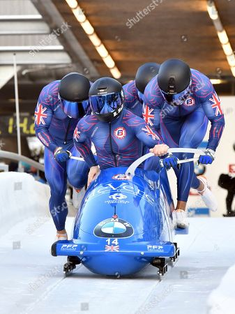 Great Britain's pilot Brad Hall with Lawrence Taylor, Luke Dawes and Greg Cackett start their first run of the men's four-man bobsled World Cup race in Igls, near Innsbruck, Austria