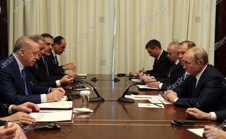 Stock Photo of A handout photo made available by the Turkish President Press Office shows, Turkish President Recep Tayyip Erdogan (L) and Russian President Vladimir Putin (R) meet for a bilateral on the sidelines of the International Libya Conference in Berlin, Germany, 19 January 2020. By means of the 'Berlin Process', German government seeks to support the peace efforts of the United Nations (UN) to bring about an end to the conflict in Libya. Following the renewed outbreak of hostilities in April 2019, UN presented a plan to stop further military escalation and resume an intra-Libyan process of reconciliation.