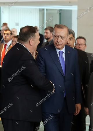 A handout photo made available by the Turkish President Press Office Turkish President Recep Tayyip Erdogan (R) and US Secretary of State Mike Pompeo (L) shake hands as they arrive for the International Libya Conference in Berlin, Germany, 19 January 2020. By means of the 'Berlin Process', German government seeks to support the peace efforts of the United Nations (UN) to bring about an end to the conflict in Libya. Following the renewed outbreak of hostilities in April 2019, UN presented a plan to stop further military escalation and resume an intra-Libyan process of reconciliation.