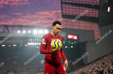 Liverpool's Trent Alexander-Arnold holds the ball during the English Premier League soccer match between Liverpool and Manchester United at Anfield Stadium in Liverpool