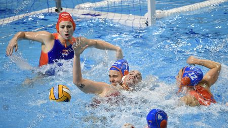 Spanish goalkeeper Elena Sanchez (L) and Maica Garcia of Spain (2R) in action against Bente Rogge (2L) and Paula Leiton (R) of the Netherlands during the women's European Water Polo Championships Group B Round 5 Spain vs Netherlands match in Budapest, Hungary, 19 January 2020.