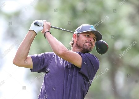 Mardy Fish, former professional tennis player, drives from the 2nd tee during during the final round of the Tournament of Champions LPGA golf tournament, in Lake Buena Vista, Fla