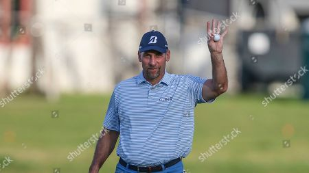 John Smoltz, former pro baseball player, shows ball to fans at the the 18th tee after winning the celebrity field the in the Tournament of Champions LPGA golf tournament, in Lake Buena Vista, Fla