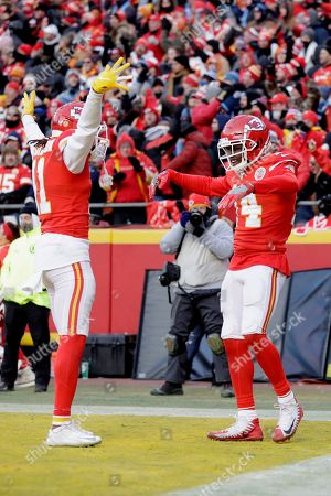 Kansas City Chiefs' Sammy Watkins, right, celebrates with Demarcus Robinson (11) after catching a touchdown pass during the second half of the NFL AFC Championship football game against the Tennessee Titans, in Kansas City, MO