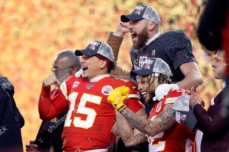 Kansas City Chiefs' Patrick Mahomes (15), Tyrann Mathieu and Travis Kelce celebrate after the NFL AFC Championship football game against the Tennessee Titans, in Kansas City, MO. The Chiefs won 35-24 to advance to Super Bowl 54