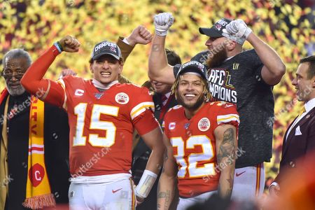 Kansas City Chiefs' Patrick Mahomes (15), Travis Kelce and Tyrann Mathieu (32) celebrate after the NFL AFC Championship football game against the Tennessee Titans, in Kansas City, MO. The Chiefs won 35-24 to advance to Super Bowl 54