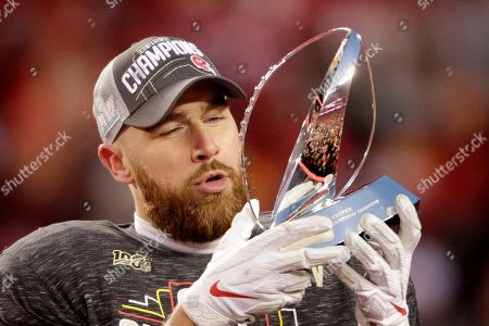 Kansas City Chiefs' Travis Kelce holds the Lamar Hunt Trophy after the NFL AFC Championship football game against the Tennessee Titans, in Kansas City, MO. The Chiefs won 35-24 to advance to Super Bowl 54