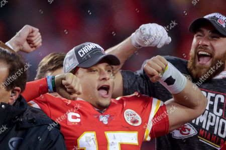 Kansas City Chiefs' Patrick Mahomes and Travis Kelce celebrate after the NFL AFC Championship football game against the Tennessee Titans, in Kansas City, MO. The Chiefs won 35-24 to advance to Super Bowl 54