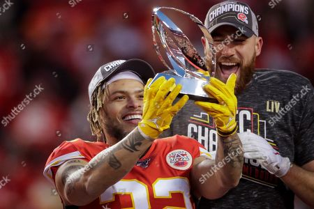 Kansas City Chiefs' Tyrann Mathieu and Travis Kelce hold up the Lamar Hunt Trophy after the NFL AFC Championship football game against the Tennessee Titans, in Kansas City, MO. The Chiefs won 35-24 to advance to Super Bowl 54
