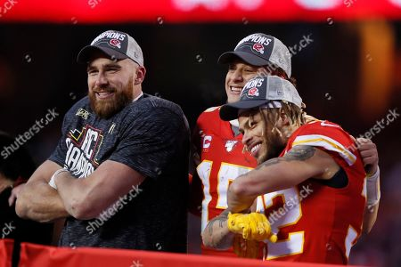 Kansas City Chiefs' Patrick Mahomes, Tyrann Mathieu and Travis Kelce celebrate after the NFL AFC Championship football game against the Tennessee Titans, in Kansas City, MO. The Chiefs won 35-24 to advance to Super Bowl 54